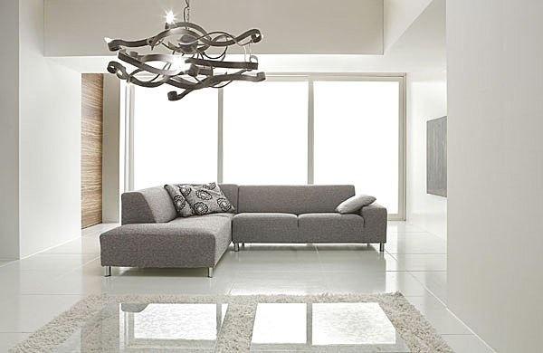 Salotto moderno con divano idee per il design della casa - Copridivano ad angolo ...